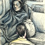 Woman in blanket on Tri-rail