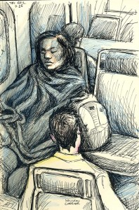 Woman in blanket on Tri-rail