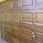 Faux wood grain fiberglass garage door